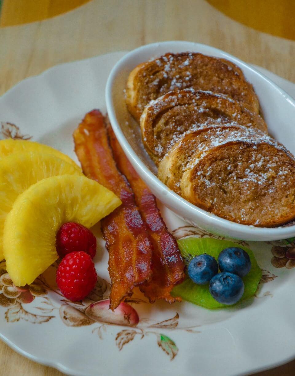 Baked Cinnamon French Toast, Crispy Bacon and Fresh Cut Pineapple