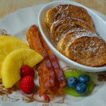 Baked Cinnamon French Toast, Crispy Bacon and Fresh Cut Pineapple