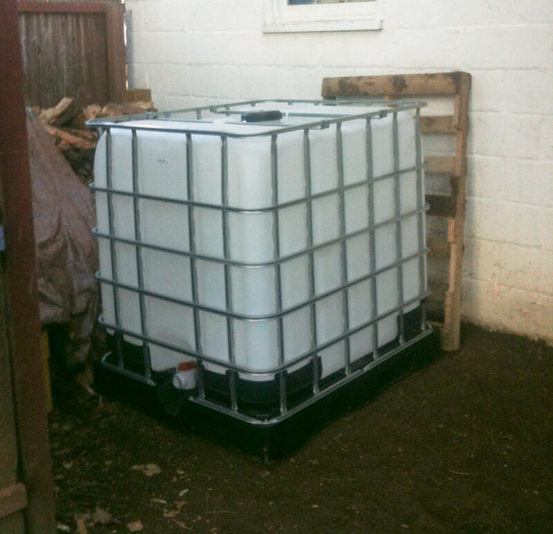 Getting ready to install our 300 gallon rain barrel for the Waypoint House vegetable garden!
