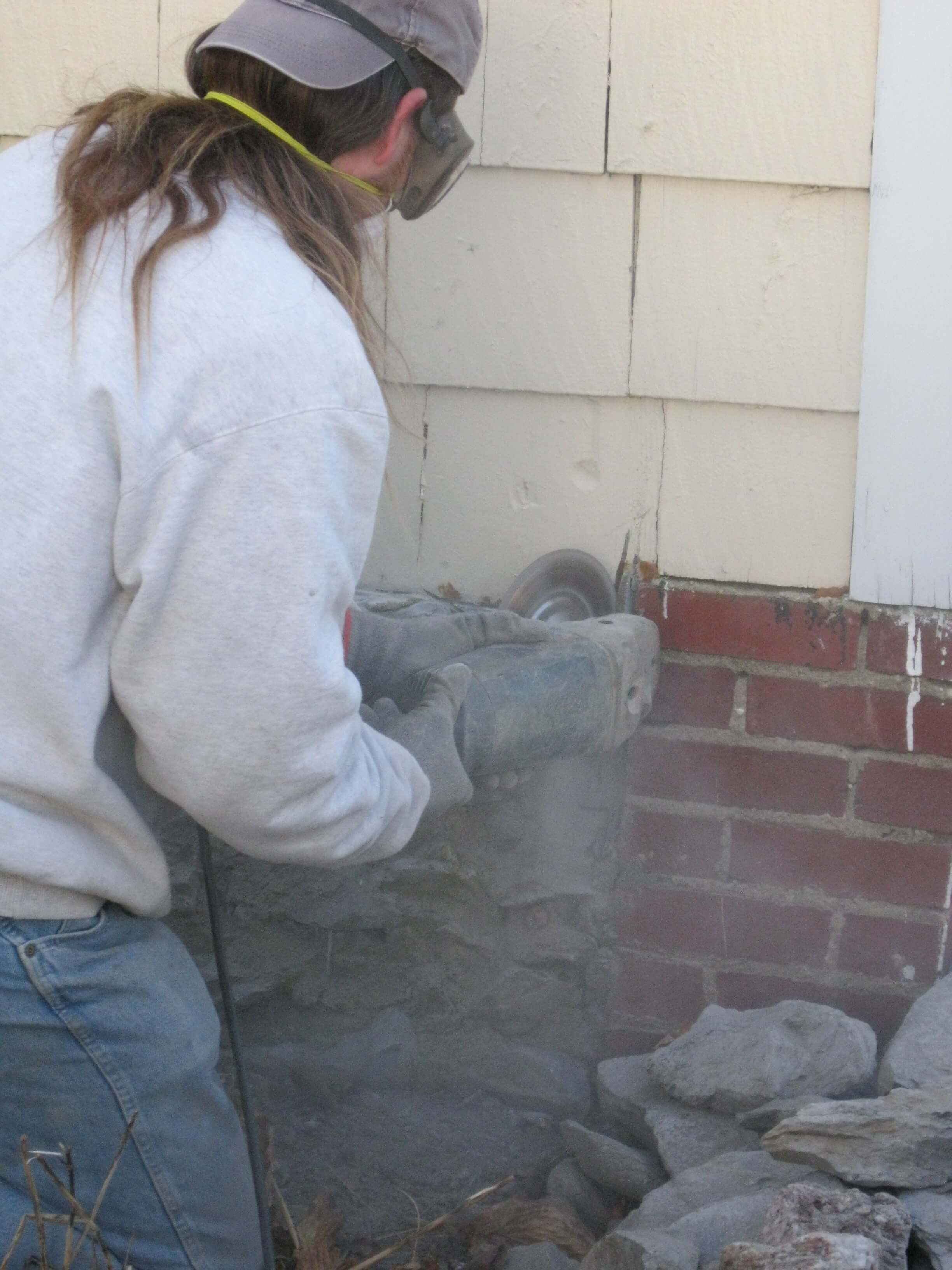 Foundation work - Old mortar out, new mortar in.