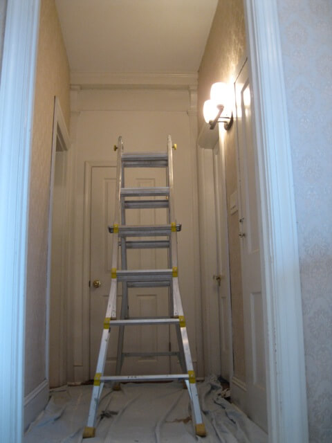 Painting in the second floor hallway